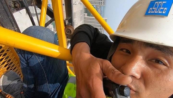 五一节探访高空工作者:他们在平凡的岗位上自豪着